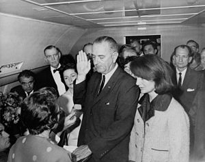 Lyndon B. Johnson taking the oath of office on...